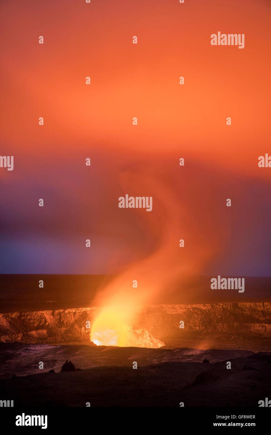 Halema'uma'u crater on Kīlauea volcano glows at evening. Hawaii Island. - Stock Image