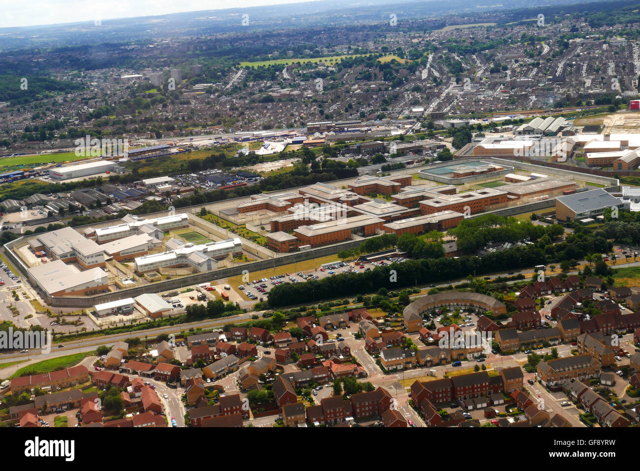 HM Prison Belmarsh, a category A mens prison in Thamesmeade, south east London from aeropane landing at City Airport - Stock Image