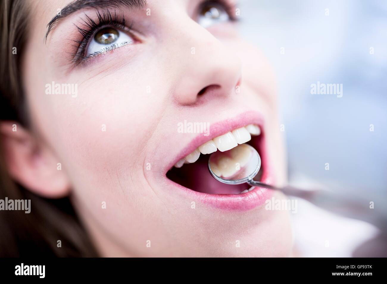 MODEL RELEASED. Close-up of woman while dental check-up. - Stock Image