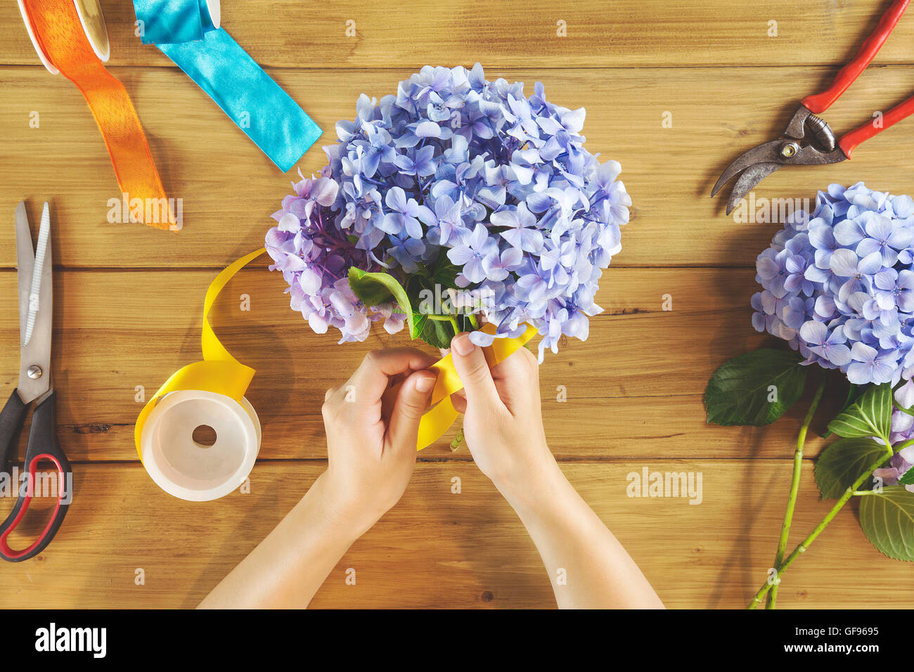 overhead of florist woman at work - Stock Image