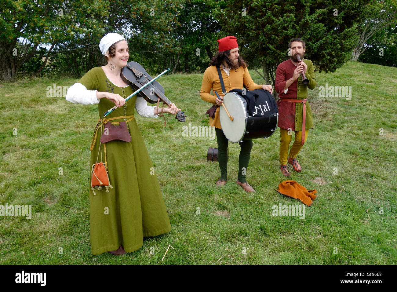 Medieval music trio band performs outdoors - Stock Image
