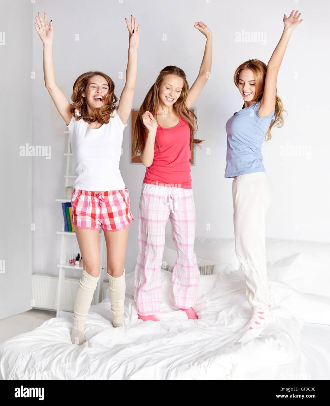 Teen girls having fun in bed