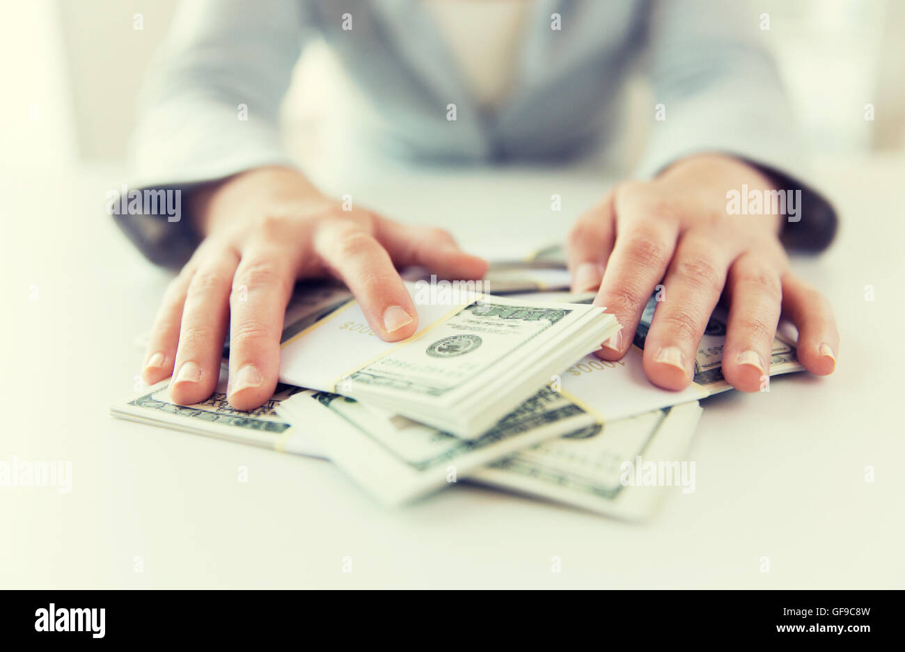 close up of woman hands counting us dollar money - Stock Image