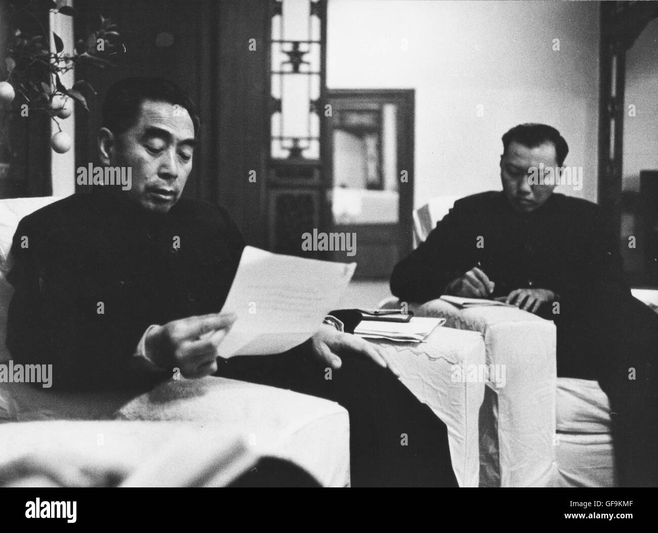 Chou En-Lai, the Premiere of the People's Republic of China, reviewing correspondence at home, 1957. - Stock Image