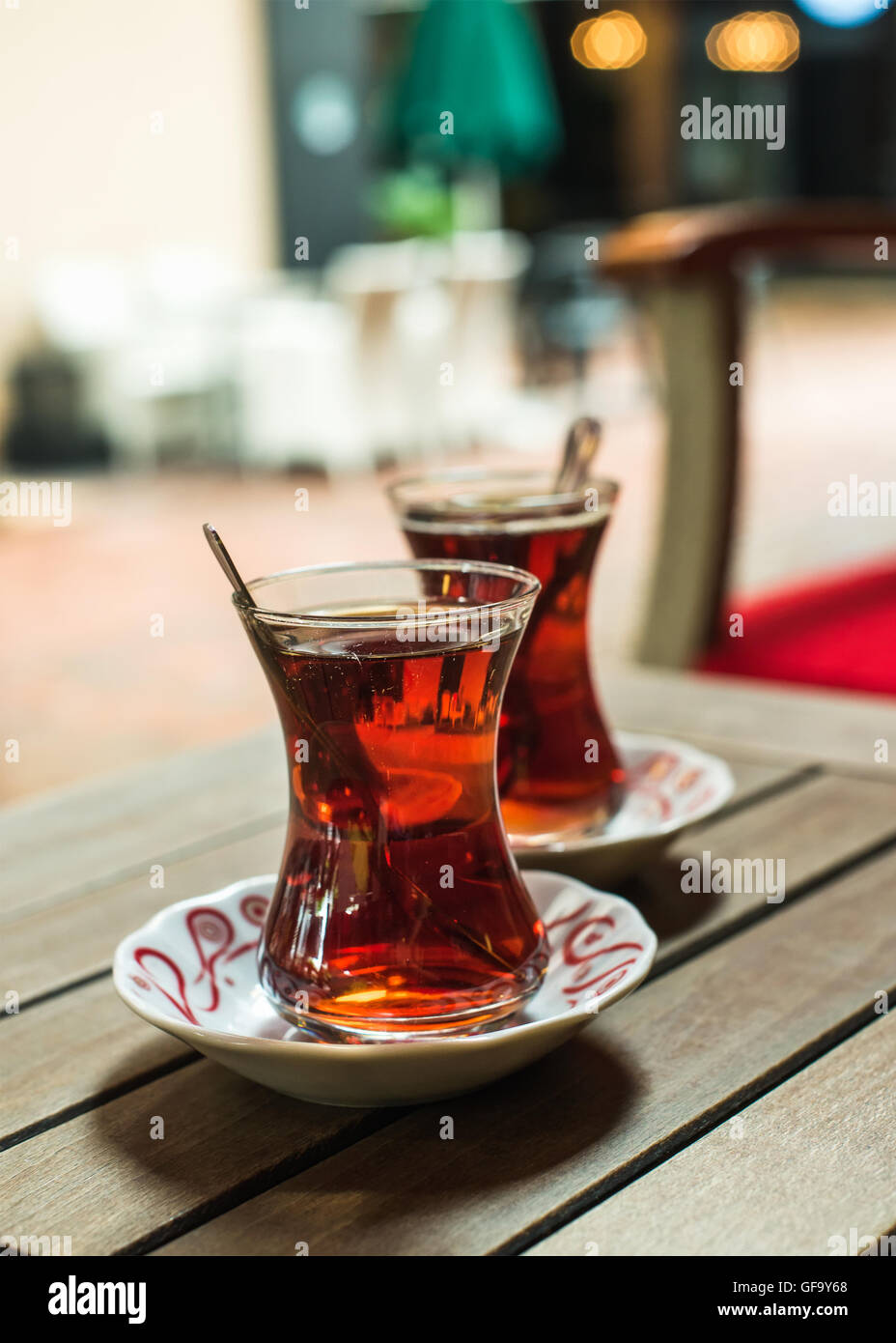Turkish tea in traditional tulip glasses on table of street cafe - Stock Image