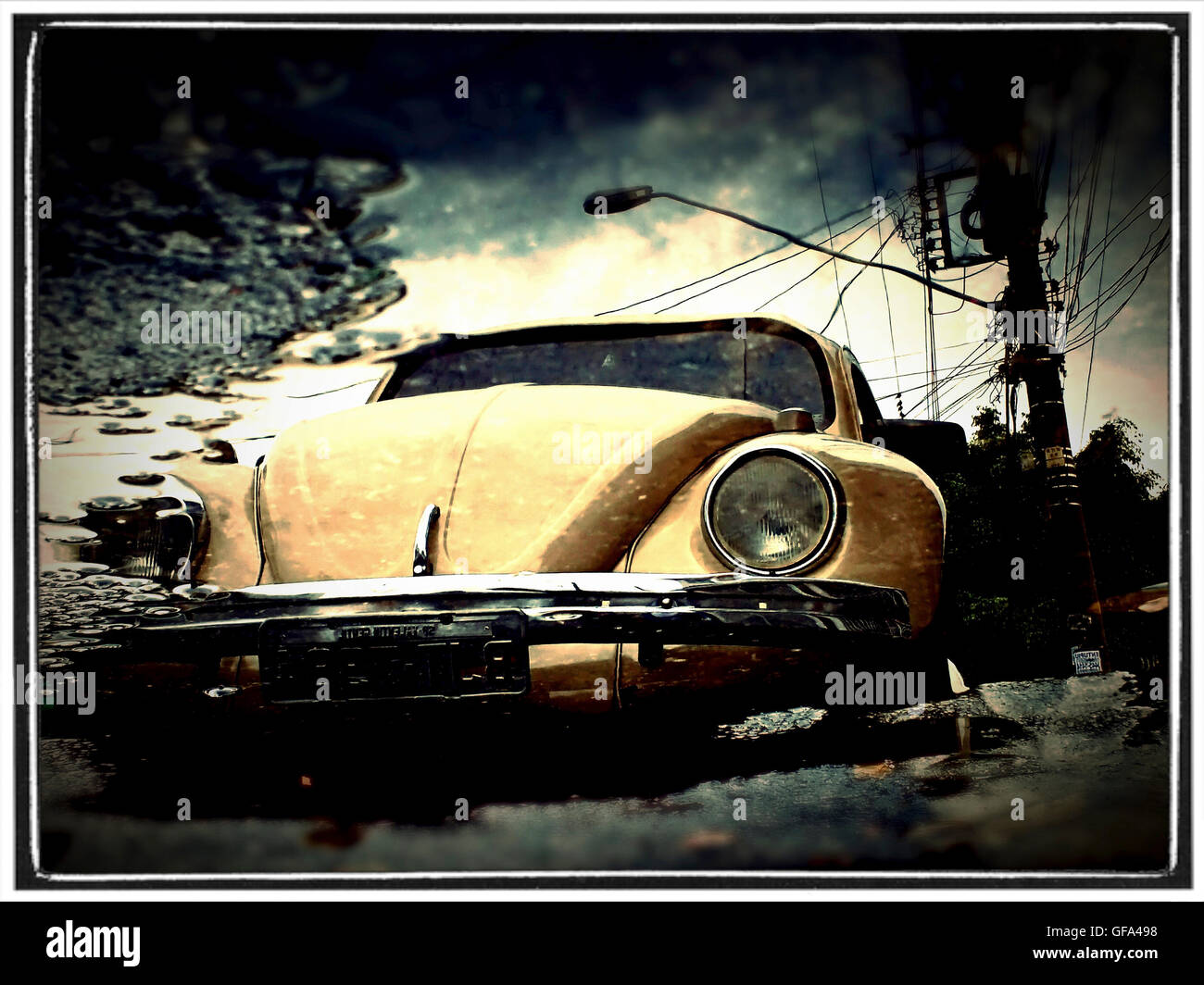 yellow vw beetle reflecting on a rainy street in  Sao Paulo - Stock Image