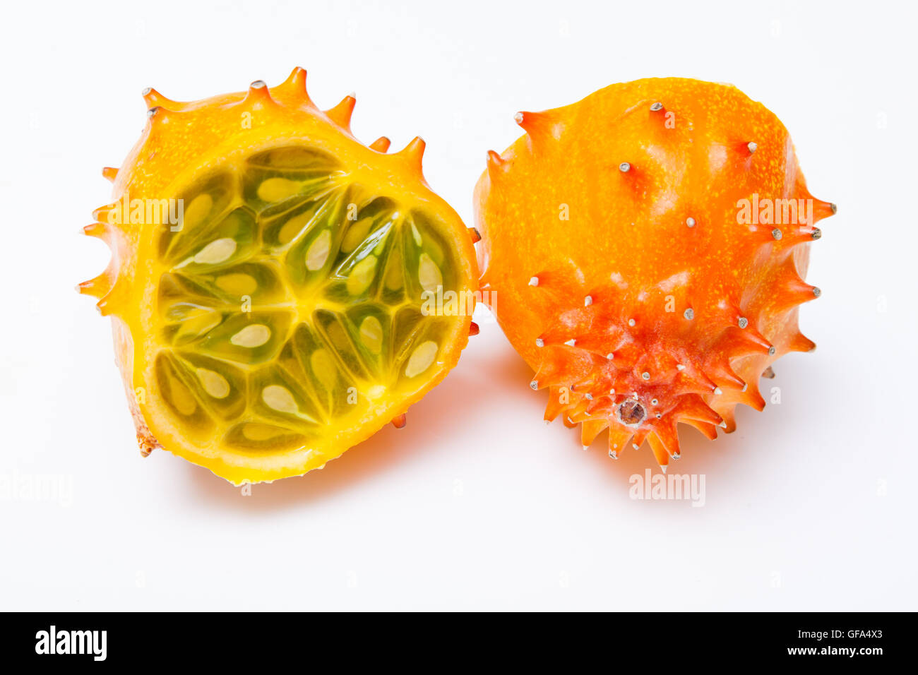 Cucumis metuliferus, horned melon or kiwano isolated on a white studio background. - Stock Image