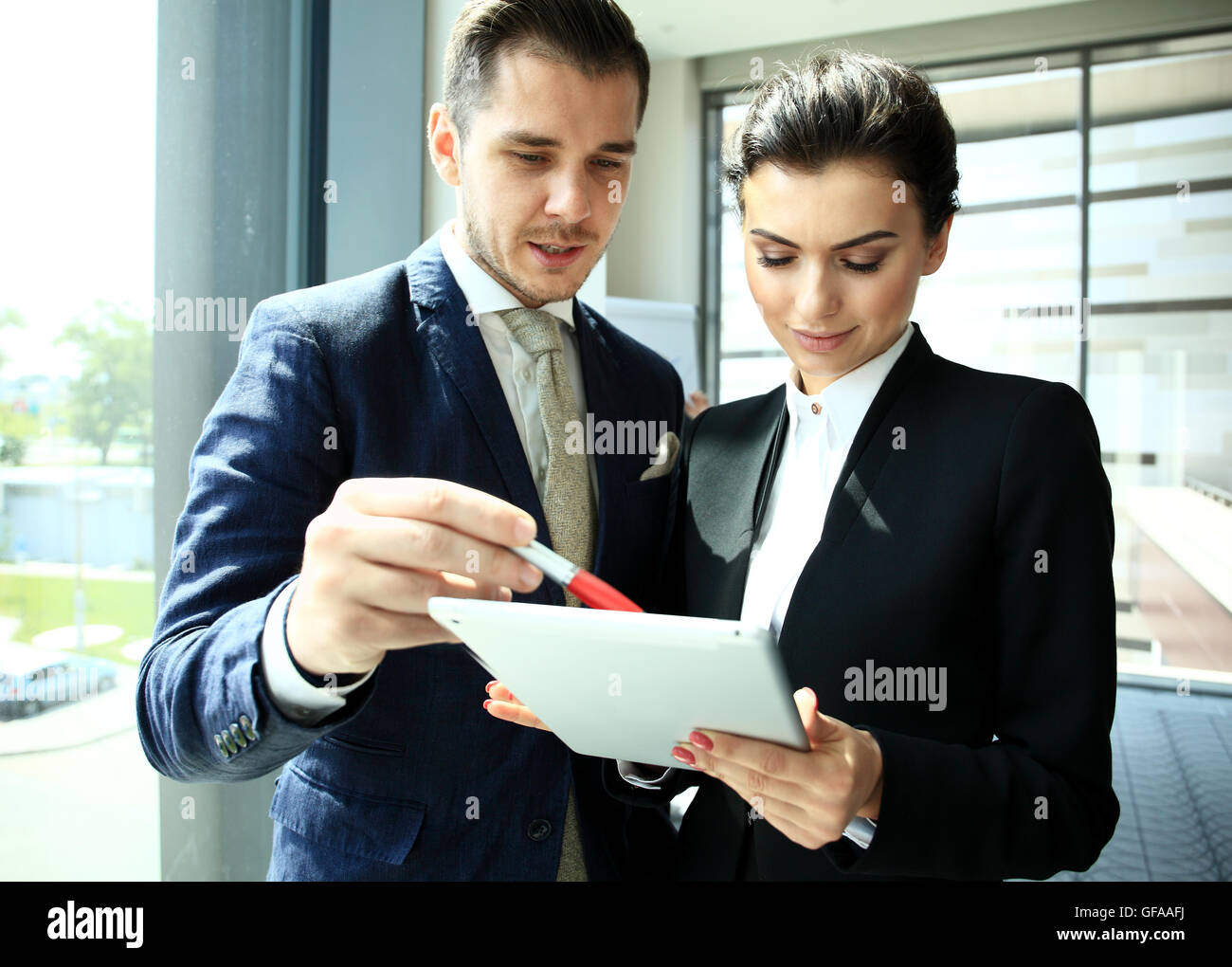 Young professionals work in modern office.Business crew working with startup. - Stock Image