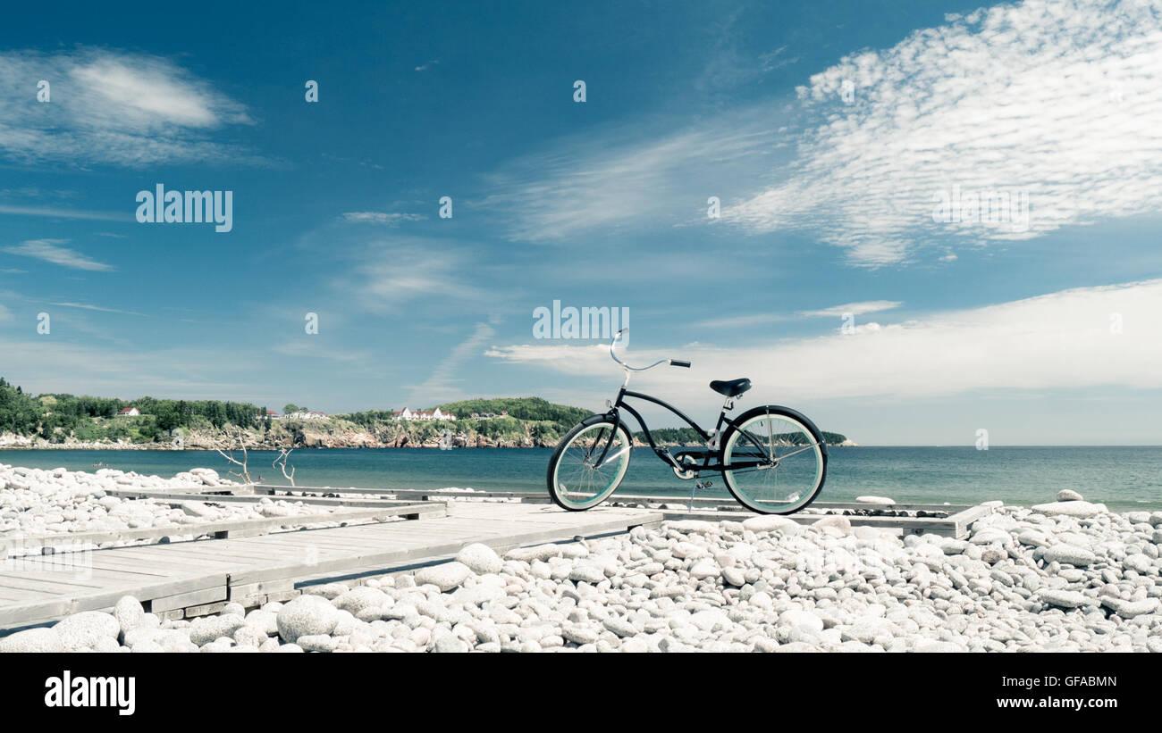 Beach bike on stony beach at Gulf of St. Lawrence - Stock Image