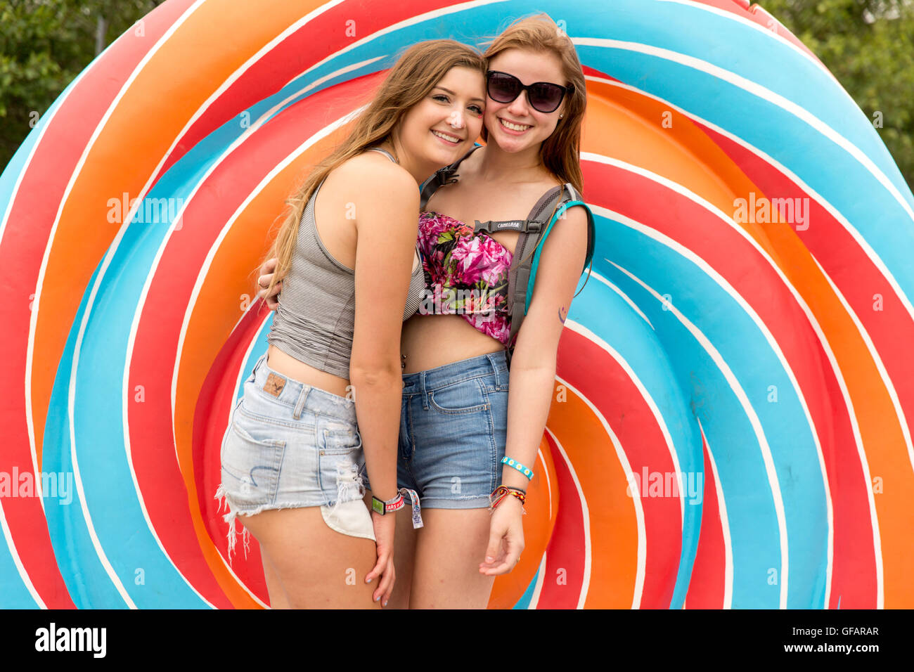 Chicago, Illinois, USA. 29th July, 2016. Female fans pose for a photo at the giant lollipop during Lollapalooza - Stock Image