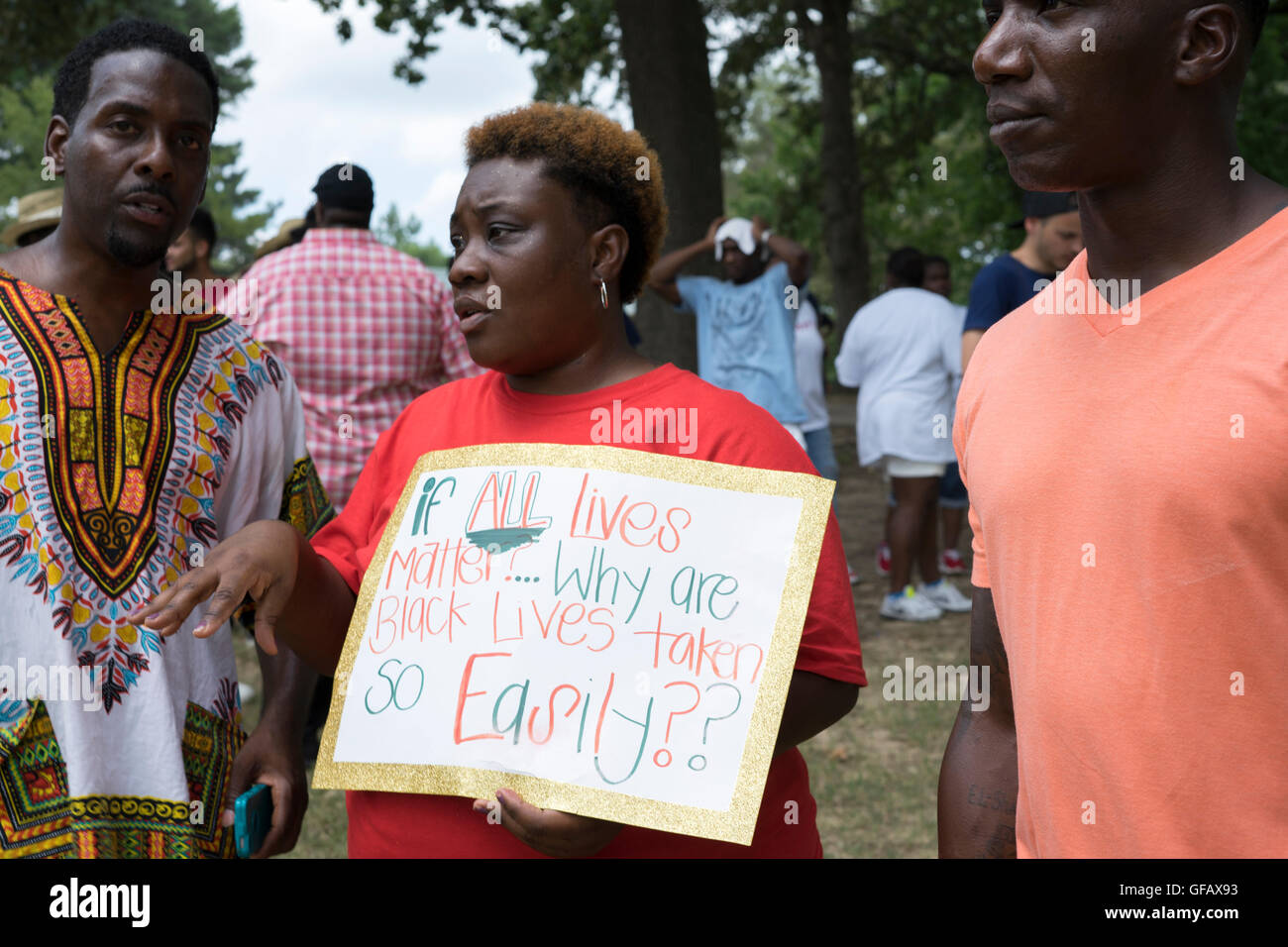 Cherisse, center, holds a sign declaring her sentiment about Black Lives Matter at a rally in Tupelo, Ms. on Saturday, - Stock Image