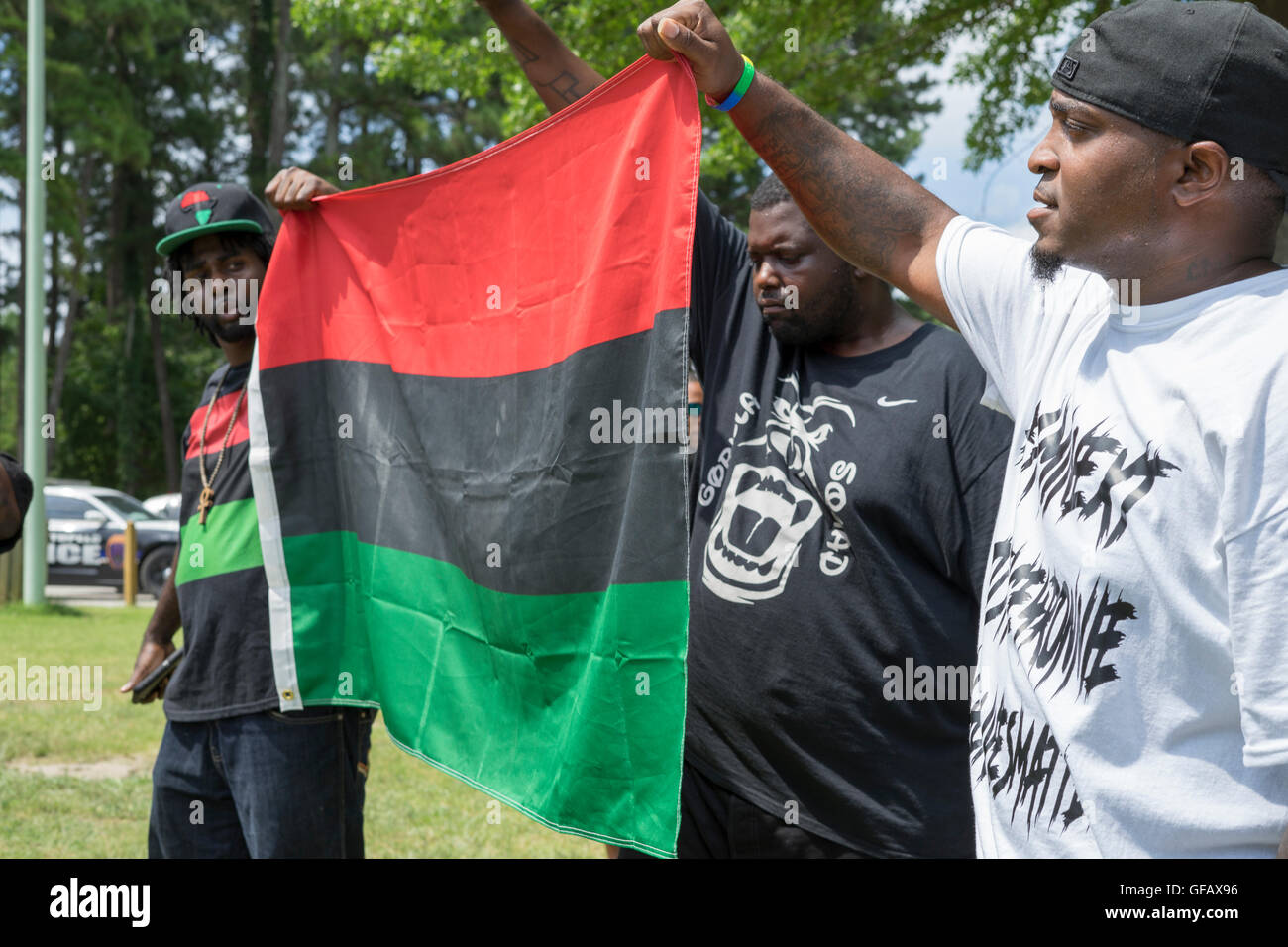 Members of Black Lives Matter display their flag at a rally in Tupelo, Ms. on Saturday, July 30th. Credit:  Tim - Stock Image