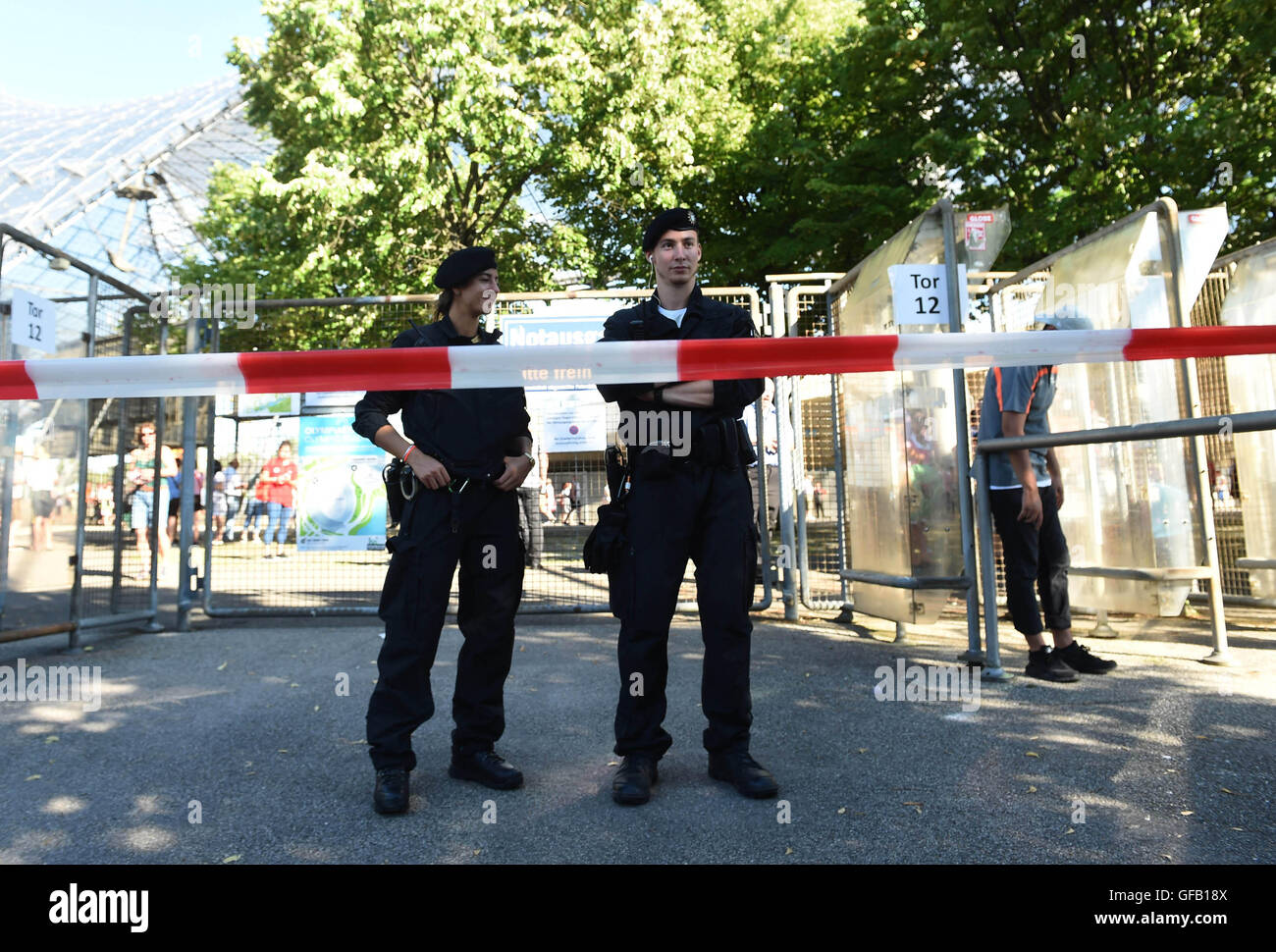 Munich, Germany. 30th July, 2016. Police stand in front of Olympiastadion where Austrian singer Andreas Gabalier - Stock Image