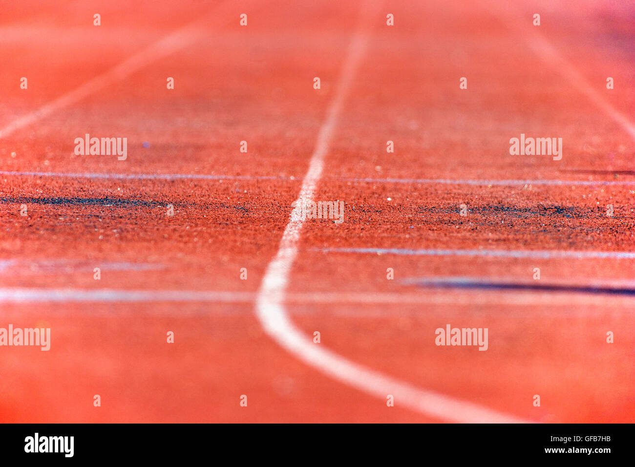 Close up of the synthetic track surface at a high school track & field meet - Stock Image