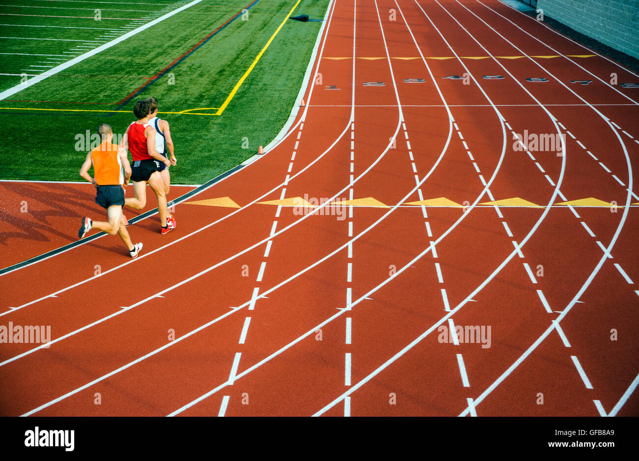 Teenage male athletes race at 2nd Annual Pennsylvania Distance Festival Track Meet - Stock Image