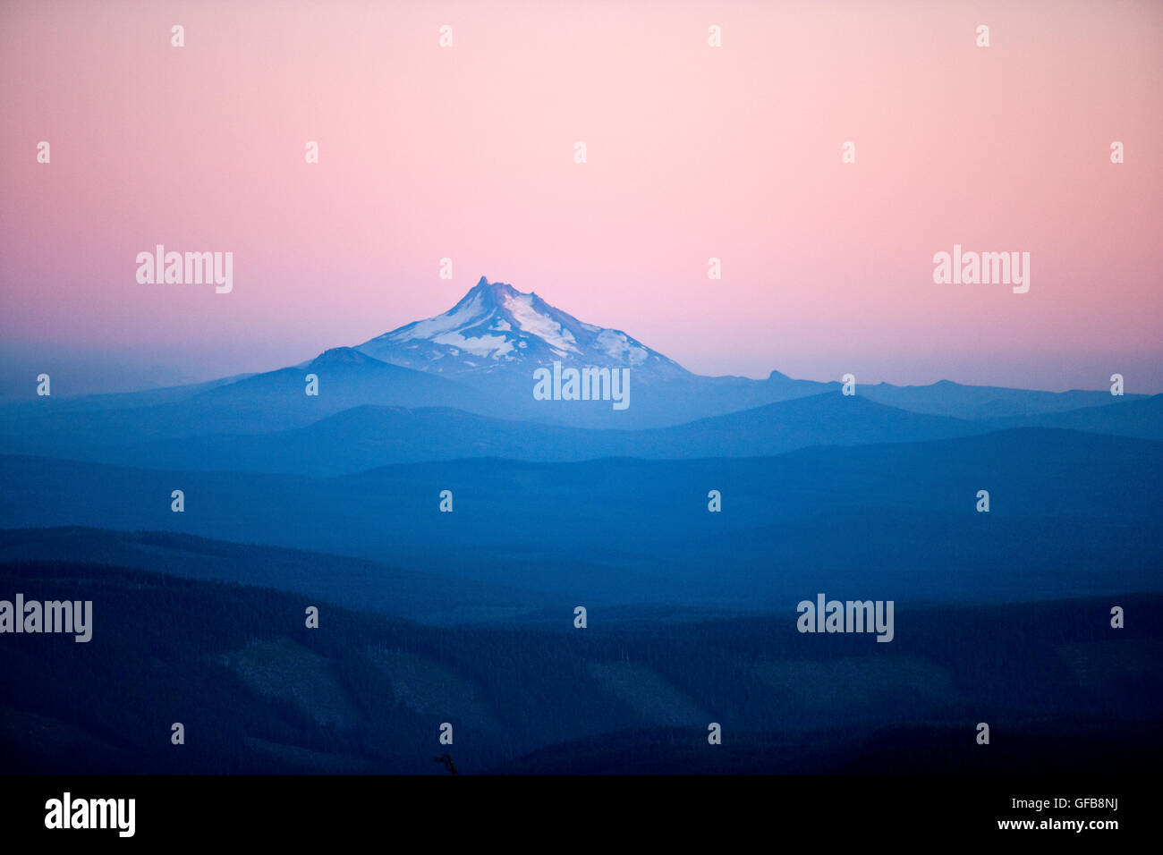 Mt. Jefferson, viewed at dusk from the Historic Timberline Lodge on Mount Hood, Oregon. - Stock Image