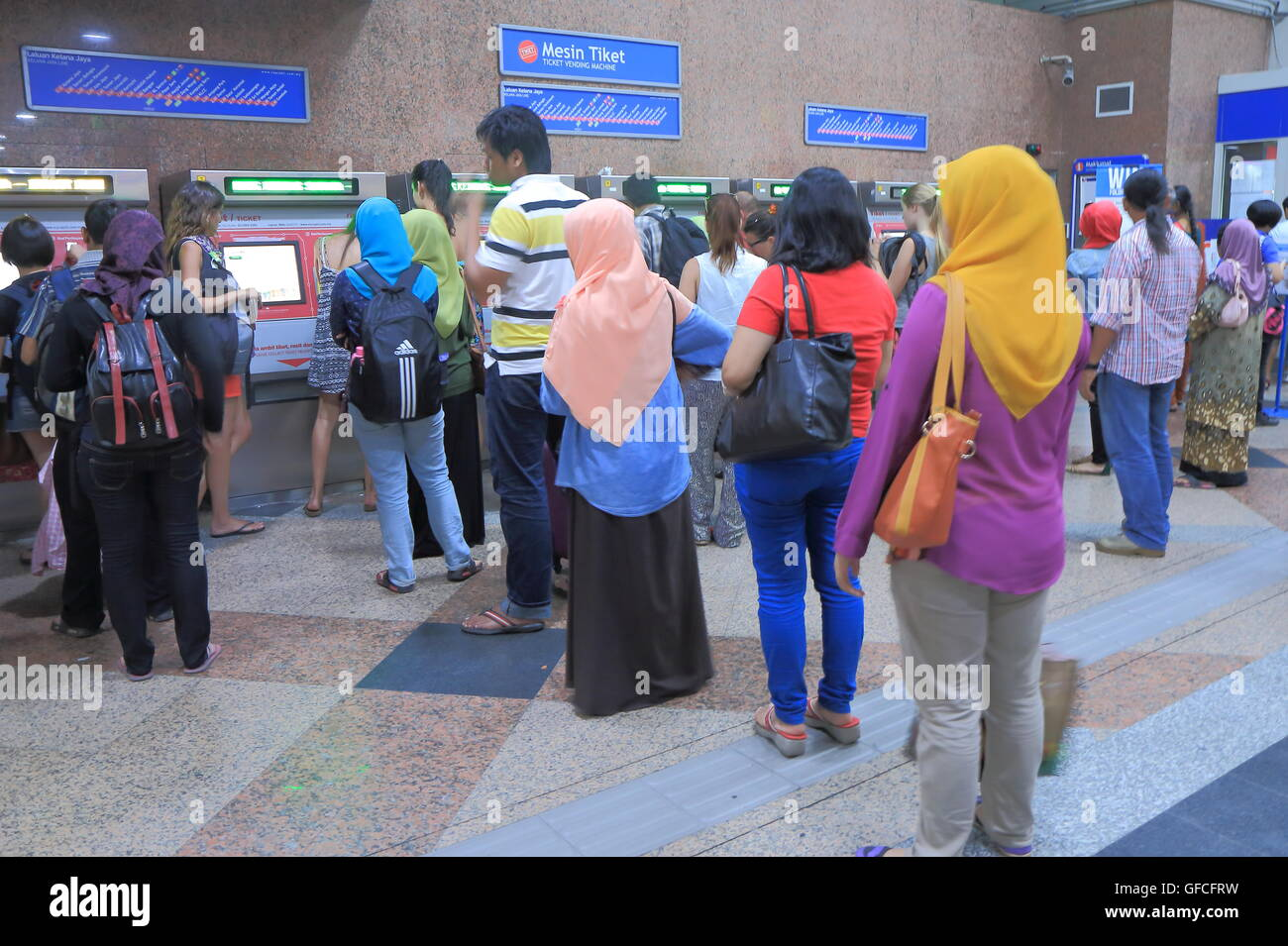 People queue for ticket machines at KL Sentral Station in Kuala Lumpur Malaysia. - Stock Image