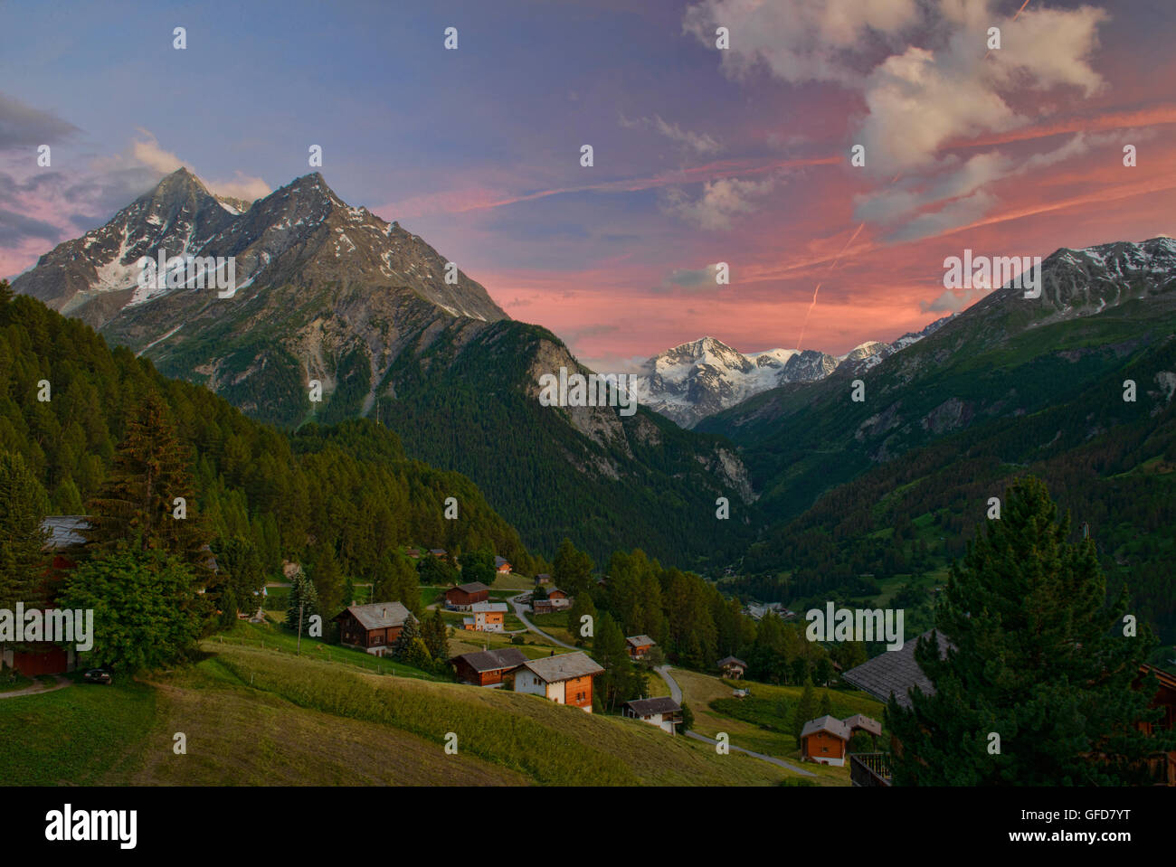 Beautiful alpine  sunset views of Pigne d'Arolla from the hamlet of La Sage, Val d'Hérens, Switzerland Stock Photo
