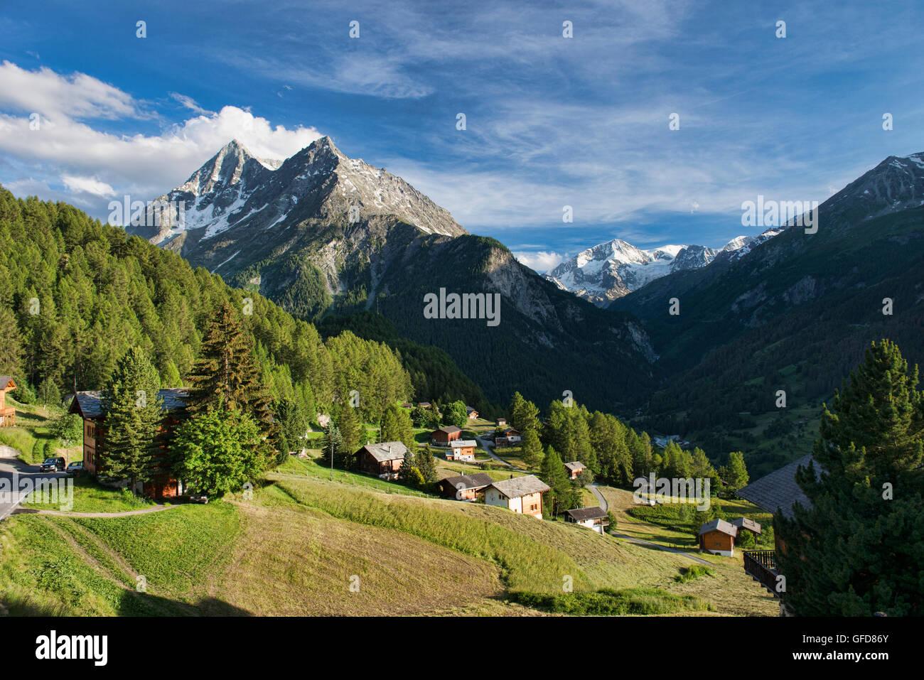 Beautiful alpine views of Pigne d'Arolla from the hamlet of La Sage, Val d'Hérens, Switzerland Stock Photo