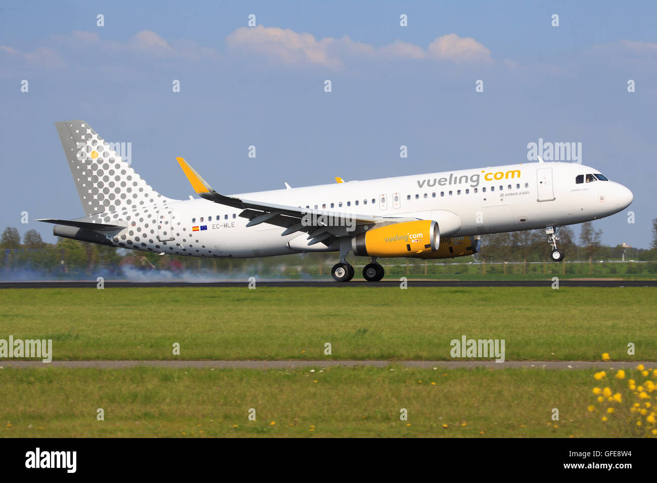 Amsterdam/Netherland march 12, 2016: Airbus A320 from Vueling landing at Amsterdam Airport - Stock Image