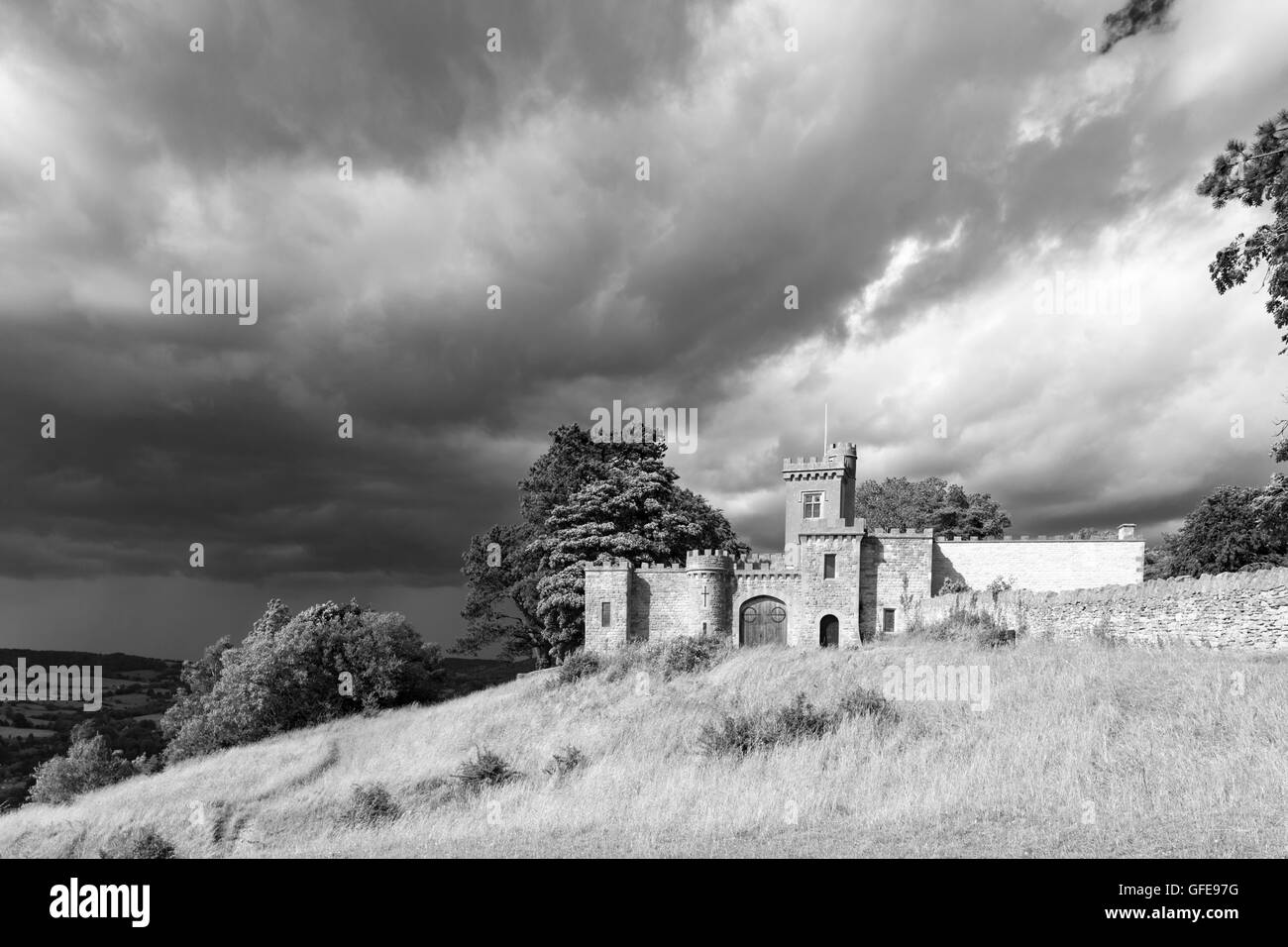 The local folly known as Rodborough Fort or Fort George in monochrome on Rodborough Common, Stroud, Gloucestershire, - Stock Image