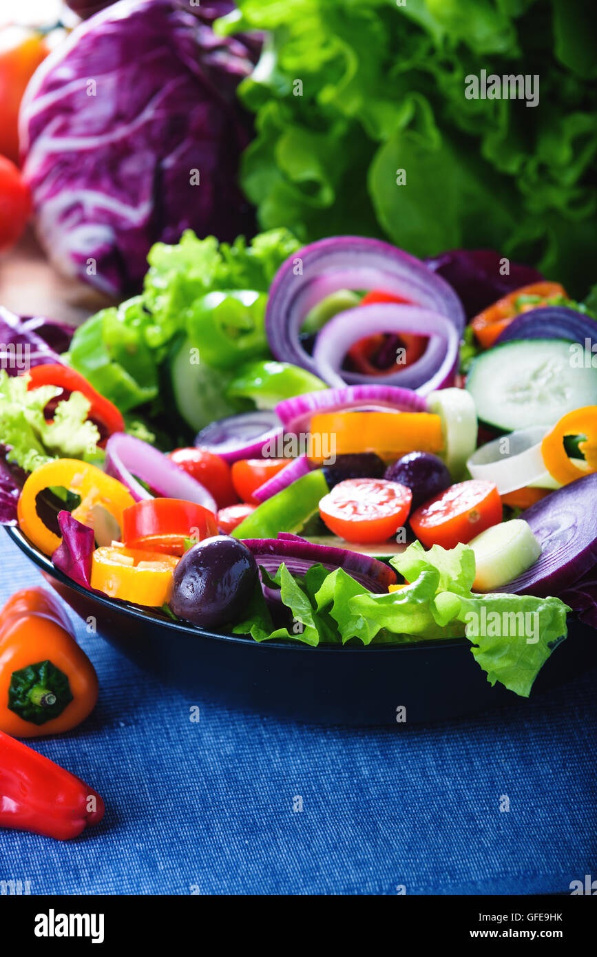 Spring salad with lots of vegetables and full of color. - Stock Image