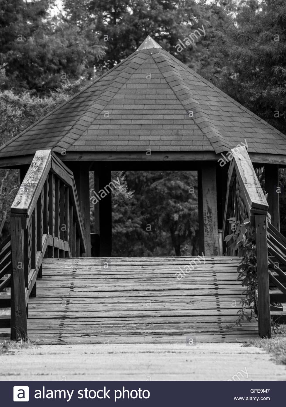 bridge to gazebo - Stock Image