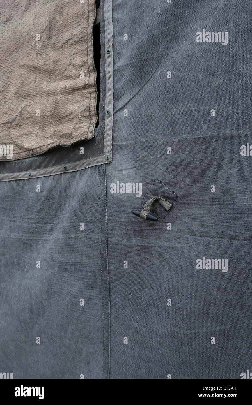 Canvas field tent section, showing window mesh and fixing toggle. - Stock Image
