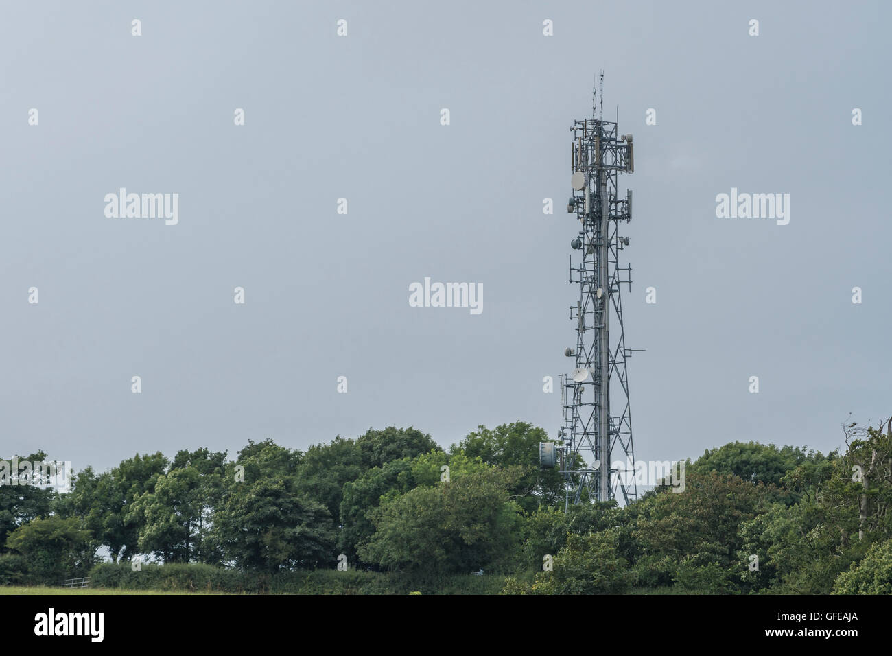 Microwave, radio and mobile / cellular telephone mast outside Truro, Cornwall. - Stock Image