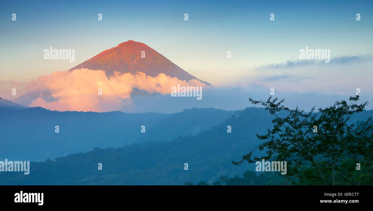 Gunung Agung Volcano at sunset, Bali, Indonesiawilderness - Stock Image