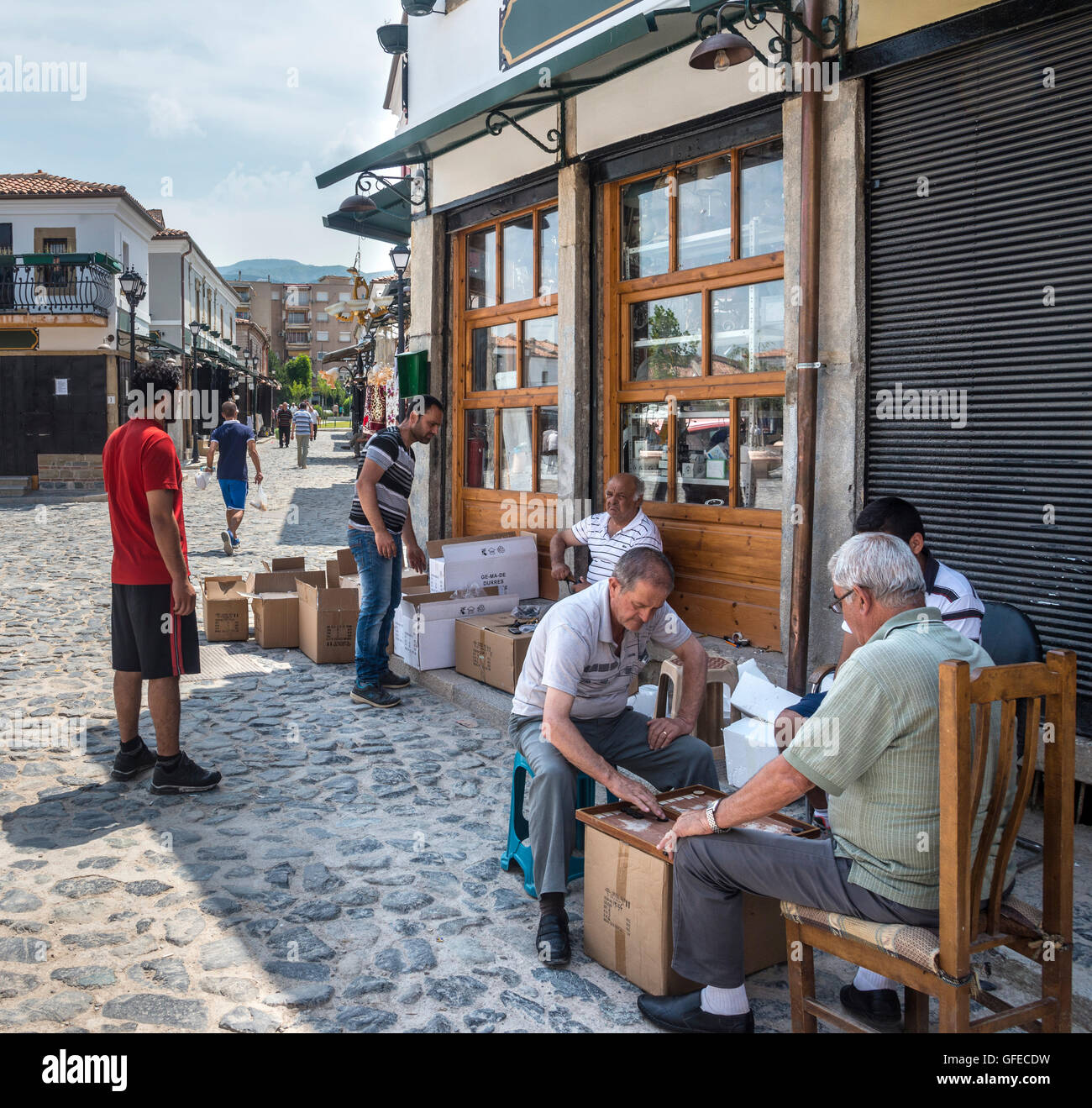 Playing backgammon in the bazaar district. Korca, South eastern Albania. - Stock Image