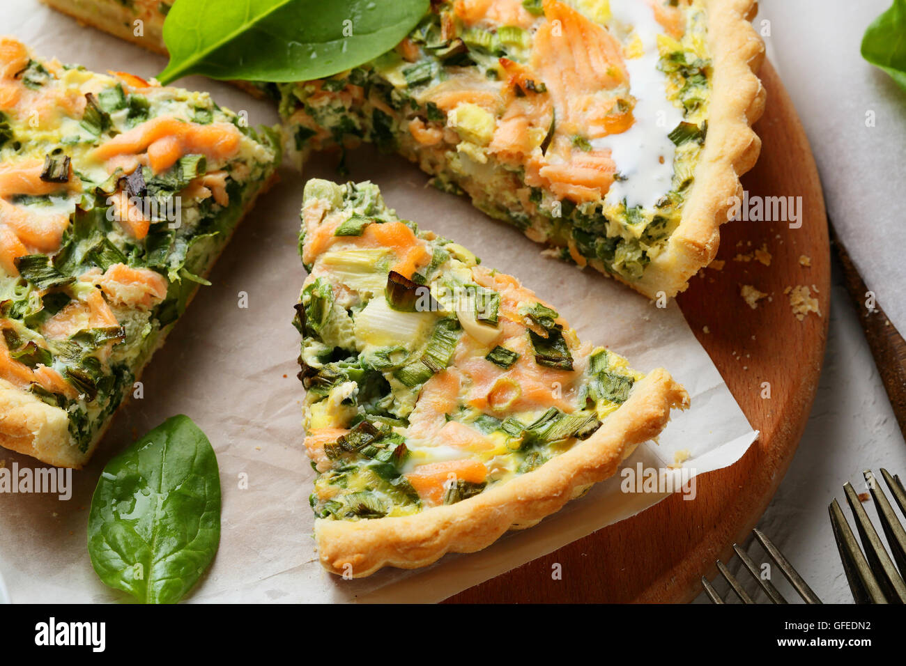 rustic salmon quiche with spinach, food - Stock Image