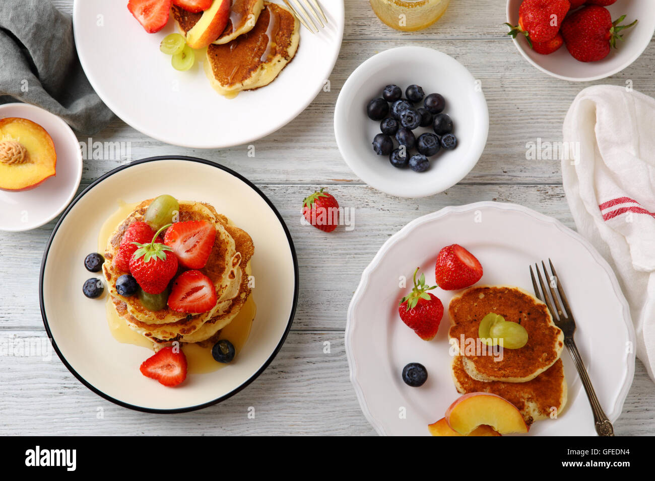 breakfast table set with pancakes, food top view Stock Photo