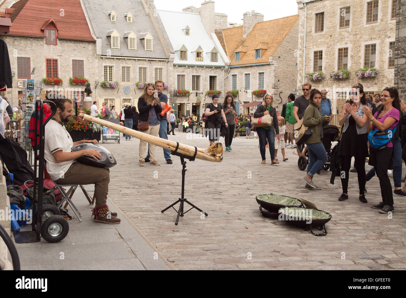 Quebec old city - Philippe Gagne - artist playing a Rav Drum based on a handpan (with didgeridoo) in Royal Square, - Stock Image