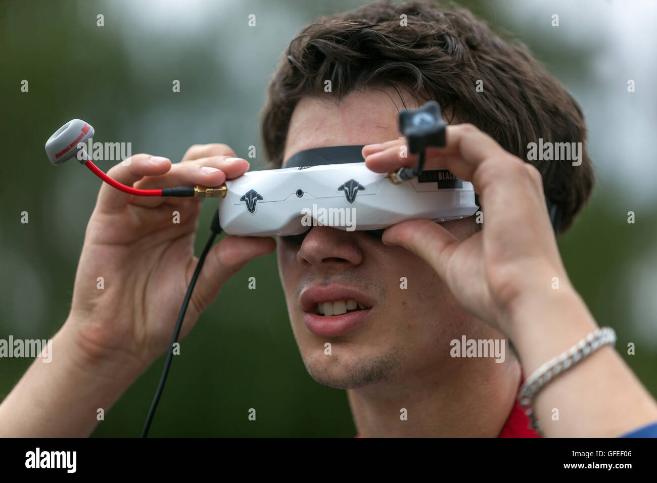 Drone pilot with glasses on its control - Stock Image