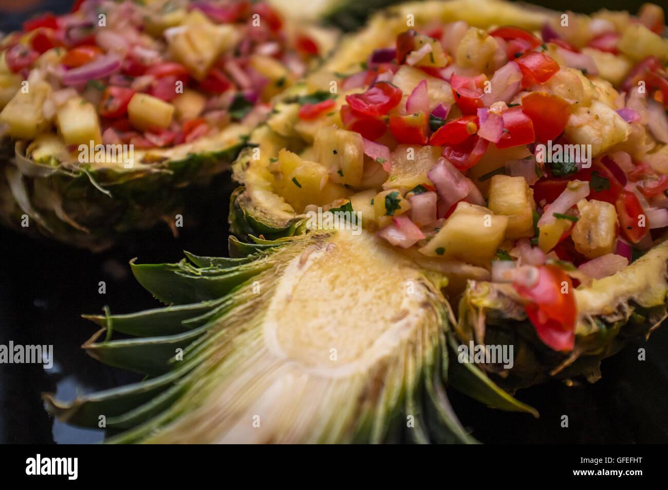 Fancy sweet whole pineapple half salsa South American appetizer Stock Photo