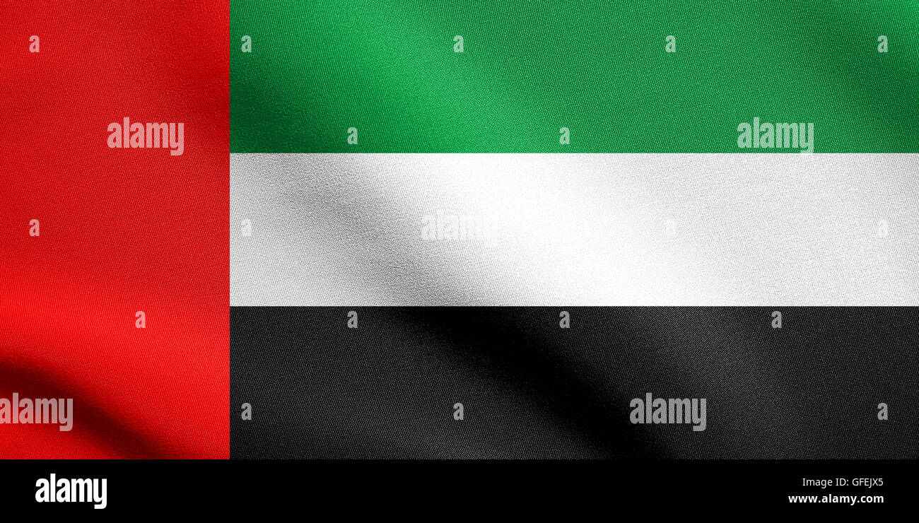 Flag of the United Arab Emirates waving in the wind with detailed fabric texture. UAE national flag. Stock Photo