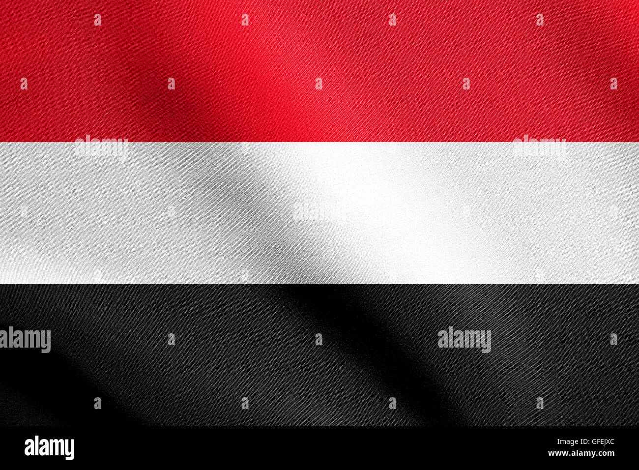 Flag of Yemen waving in the wind with detailed fabric texture. Yemeni national flag. - Stock Image