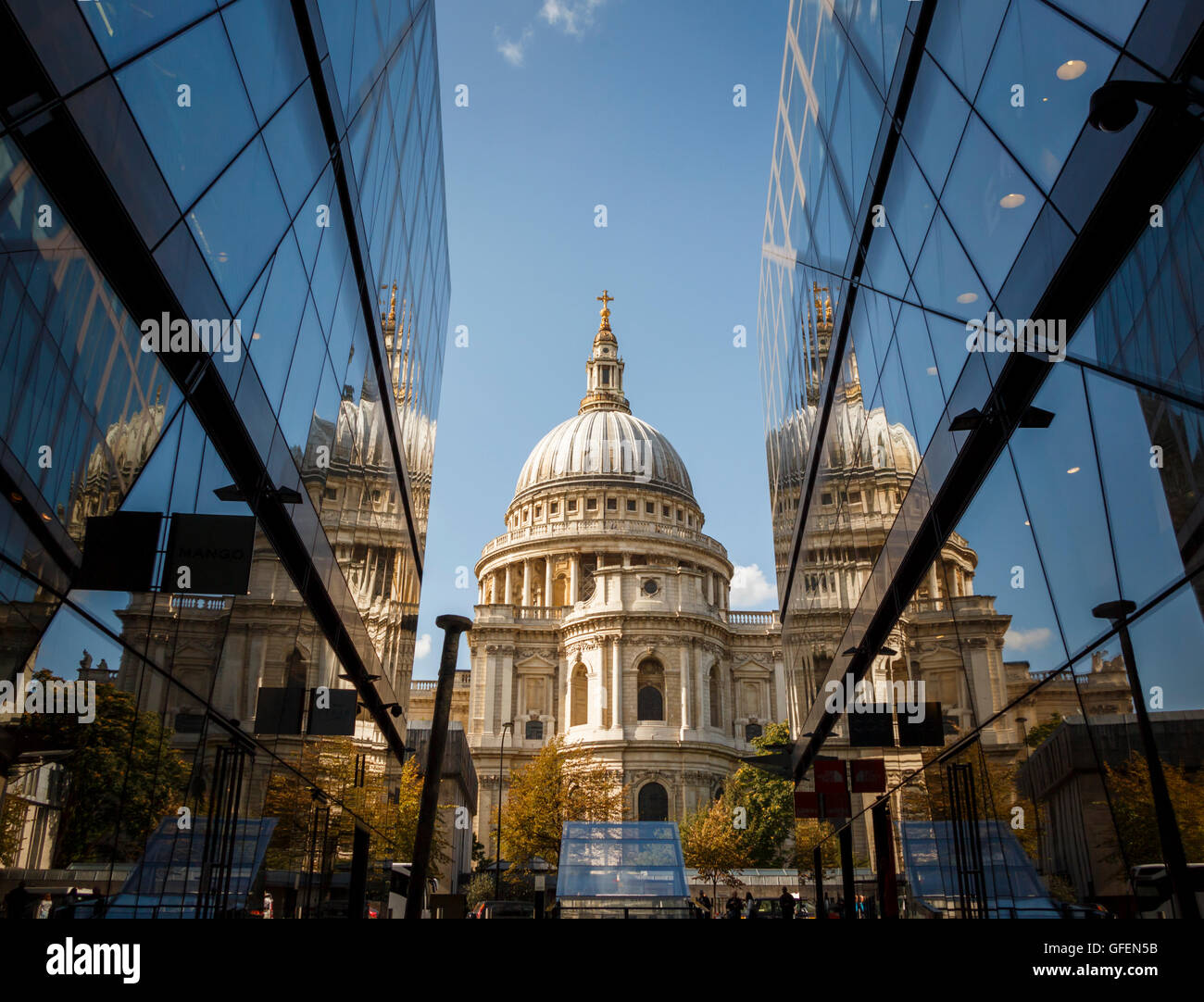 Low angle shot of St Pauls Cathedral, with reflection in the glass of 2 modern office / retail buildings - Stock Image