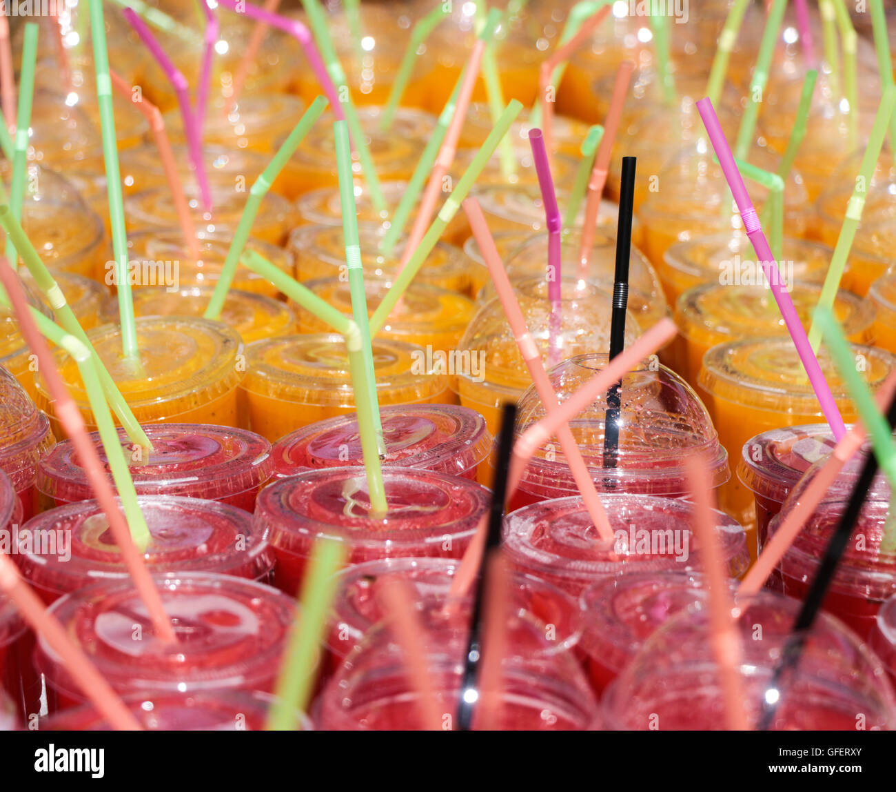 Fruit juices & Slurpy on show at Shoreditch Market in London, England - Stock Image