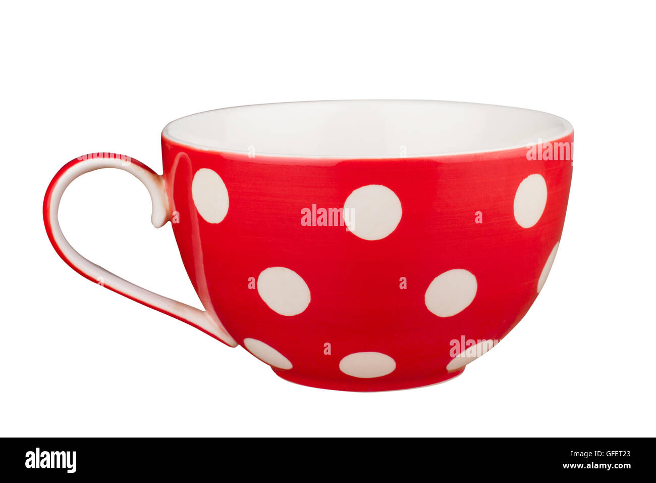Front view of a red tea empty cup with dots isolated on white - Stock Image