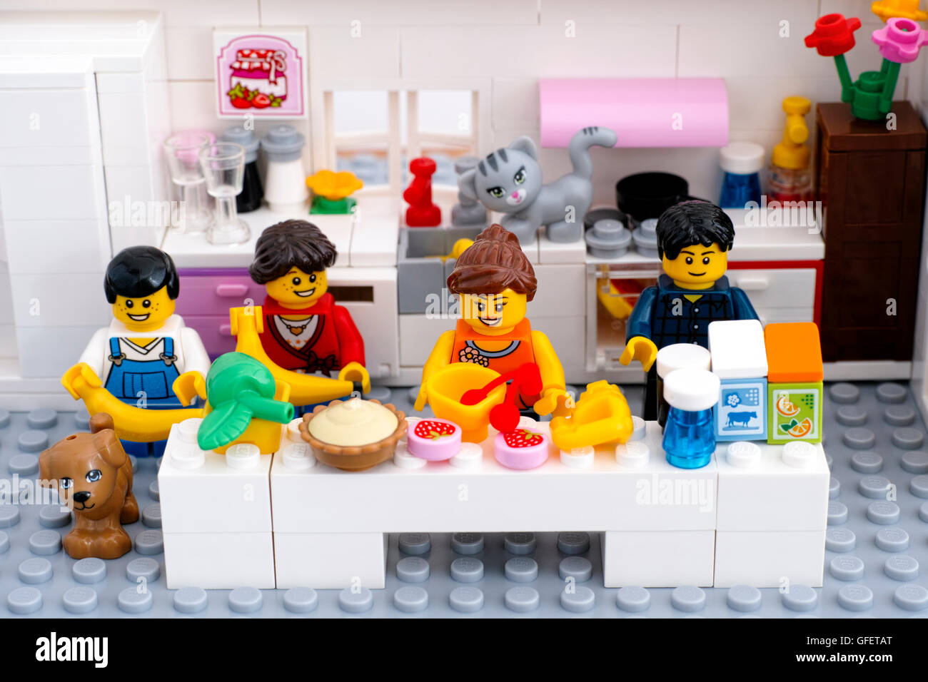 Tambov, Russian Federation - August 29, 2015 Lego family with pets in domestic kitchen. Woman is cooking dessert. - Stock Image