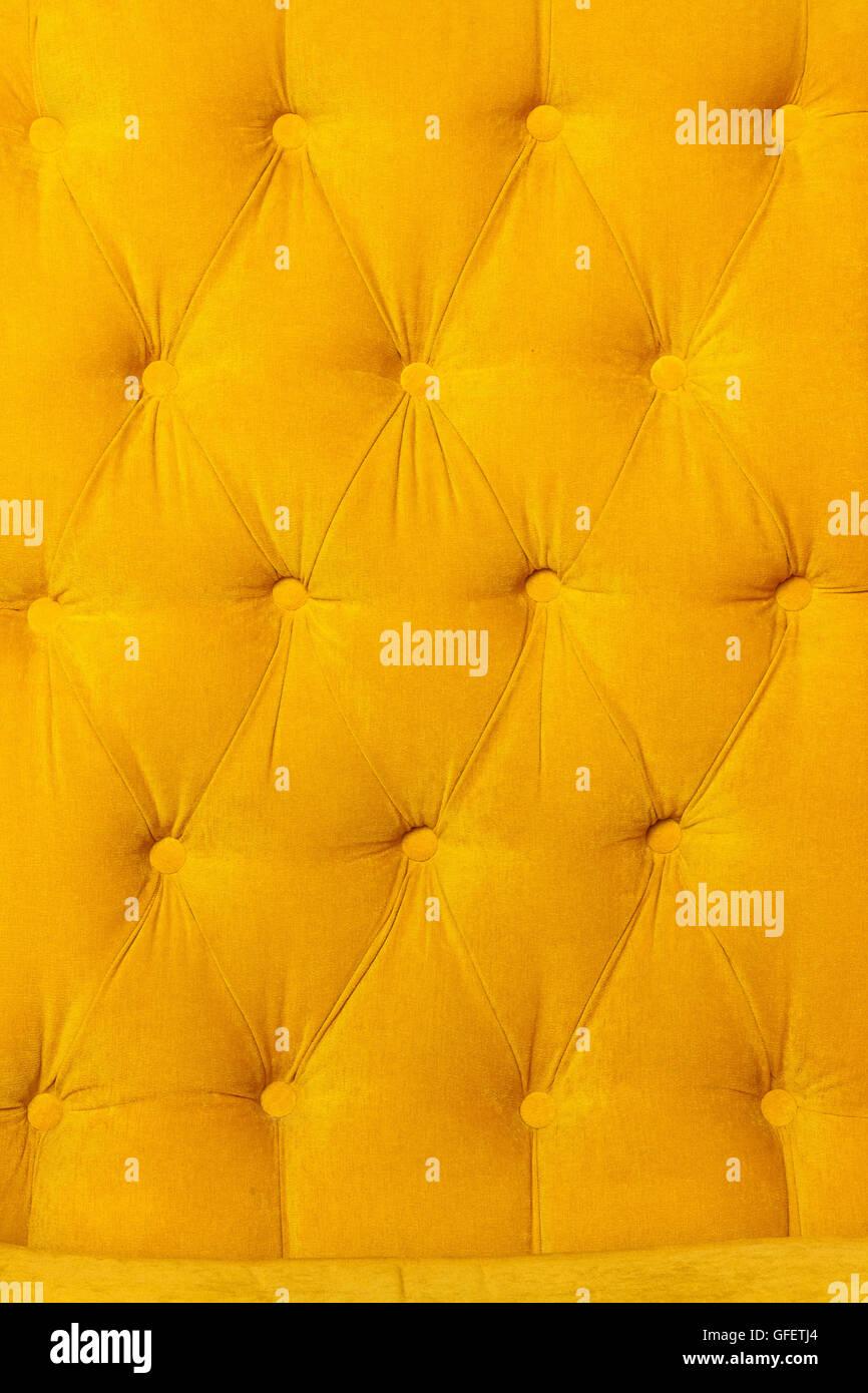 Background of velvet fabric modern yellow sofa Stock Photo ...