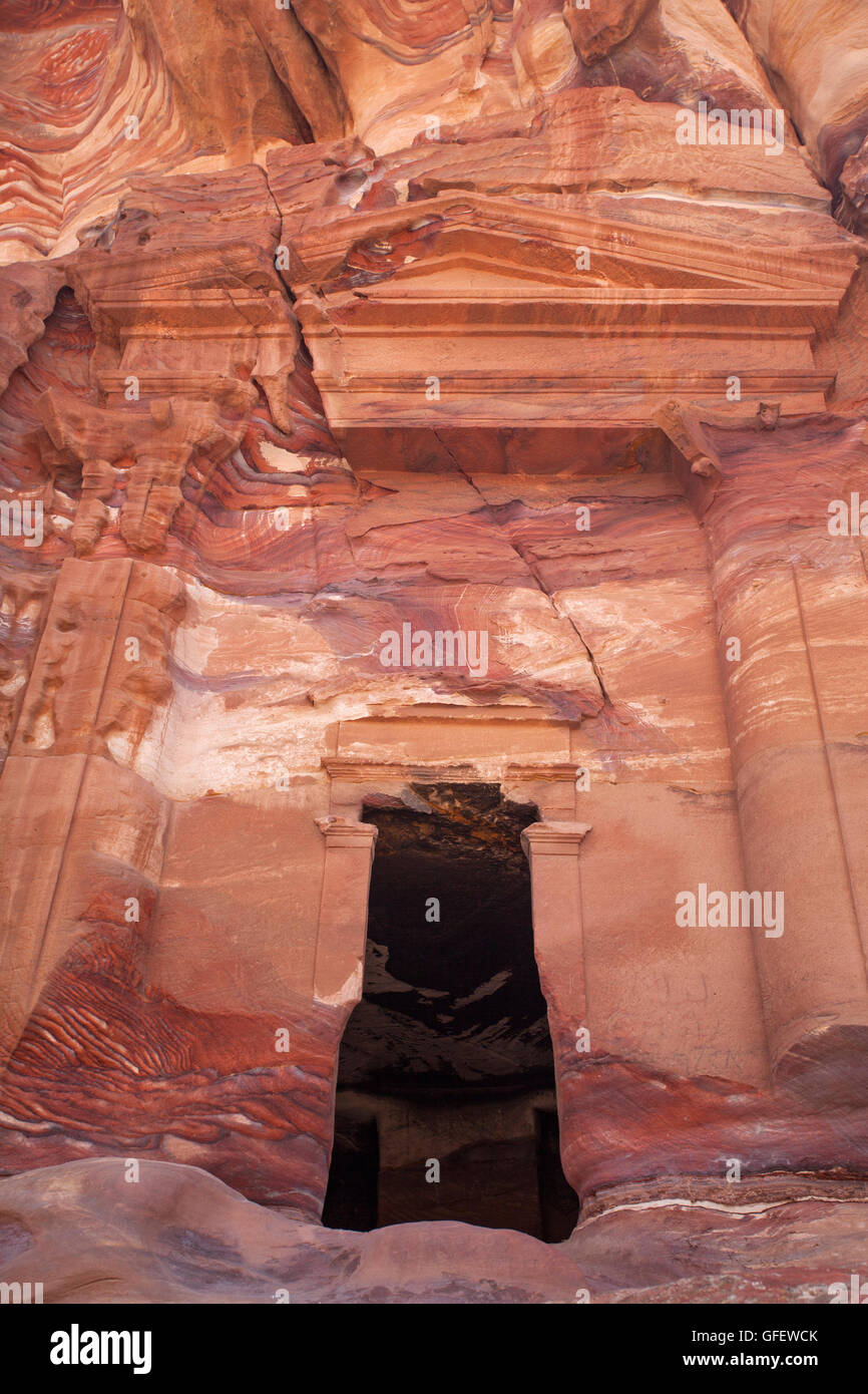 Tomb carved in the stone inside the lost city of Petra. Jordan. - Stock Image