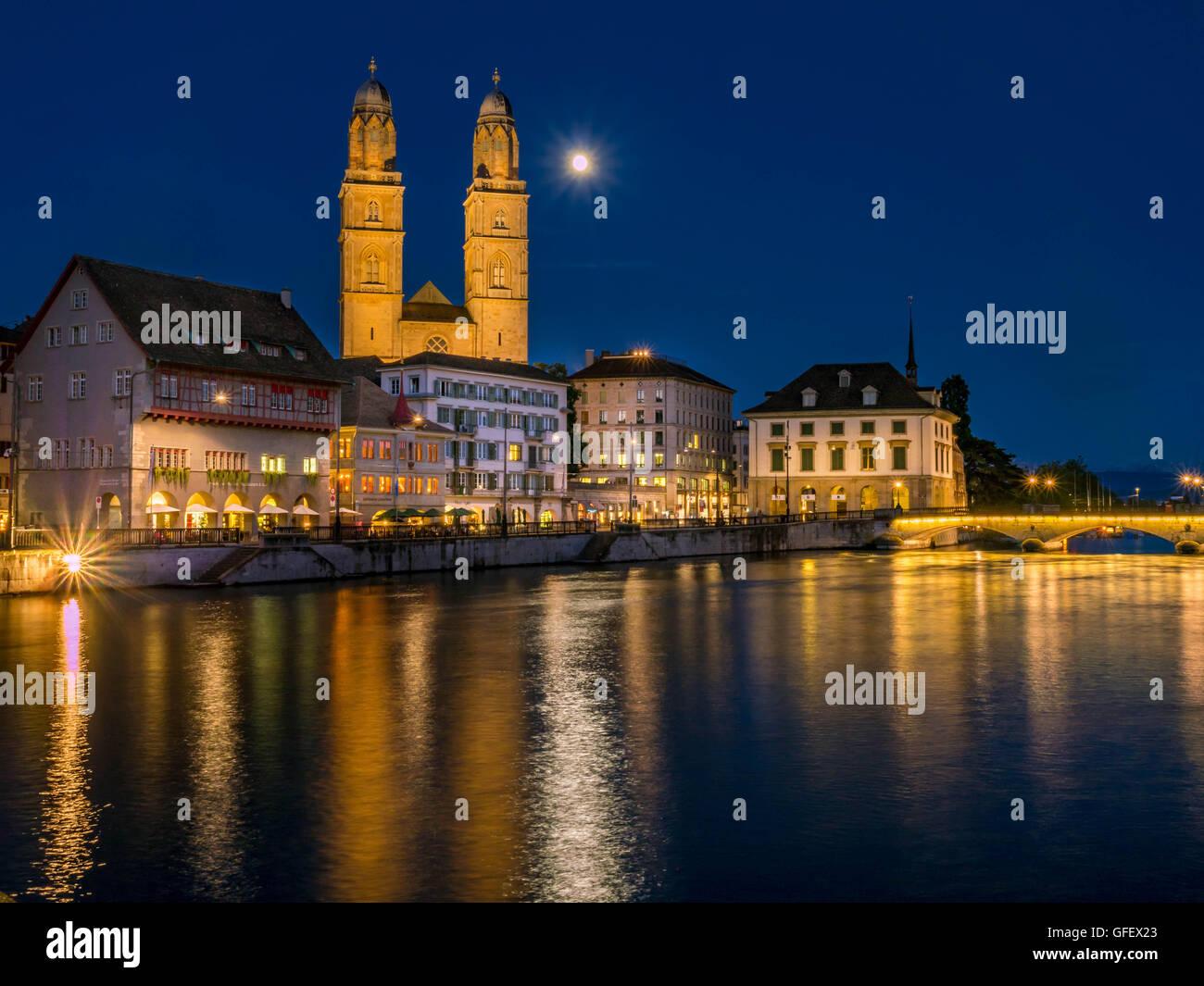 Grossmunster and Limmatquai in Zurich at night,  Switzerland, Europe - Stock Image