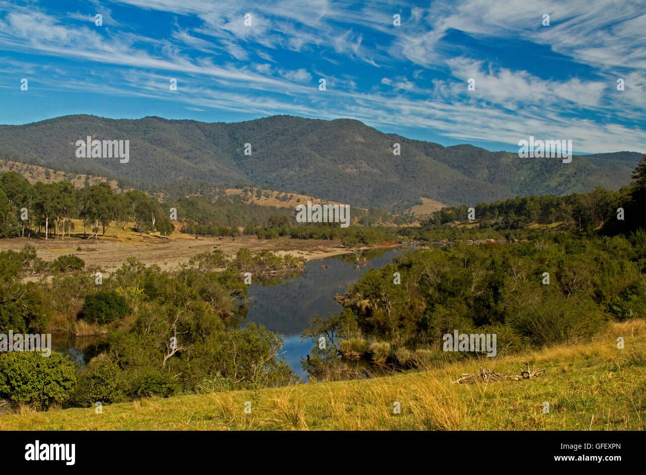 Stunning landscape, Mann River slicing through woodlands, golden grasses, forested hills of great dividing range - Stock Image