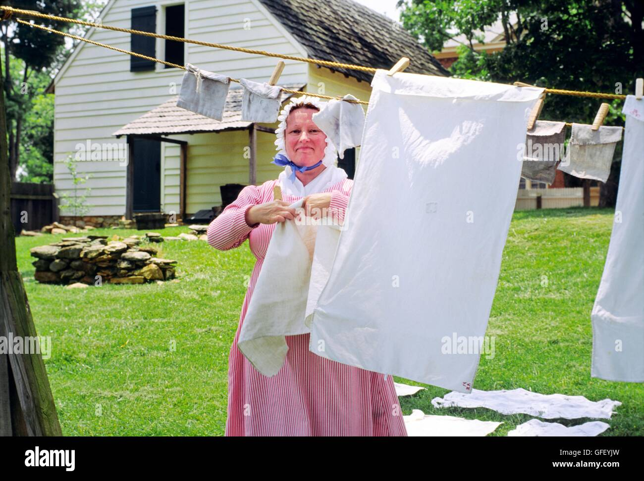 Woman washing linen in Old Salem Moravian religious community founded 1766, in modern city of Winston Salem, North - Stock Image