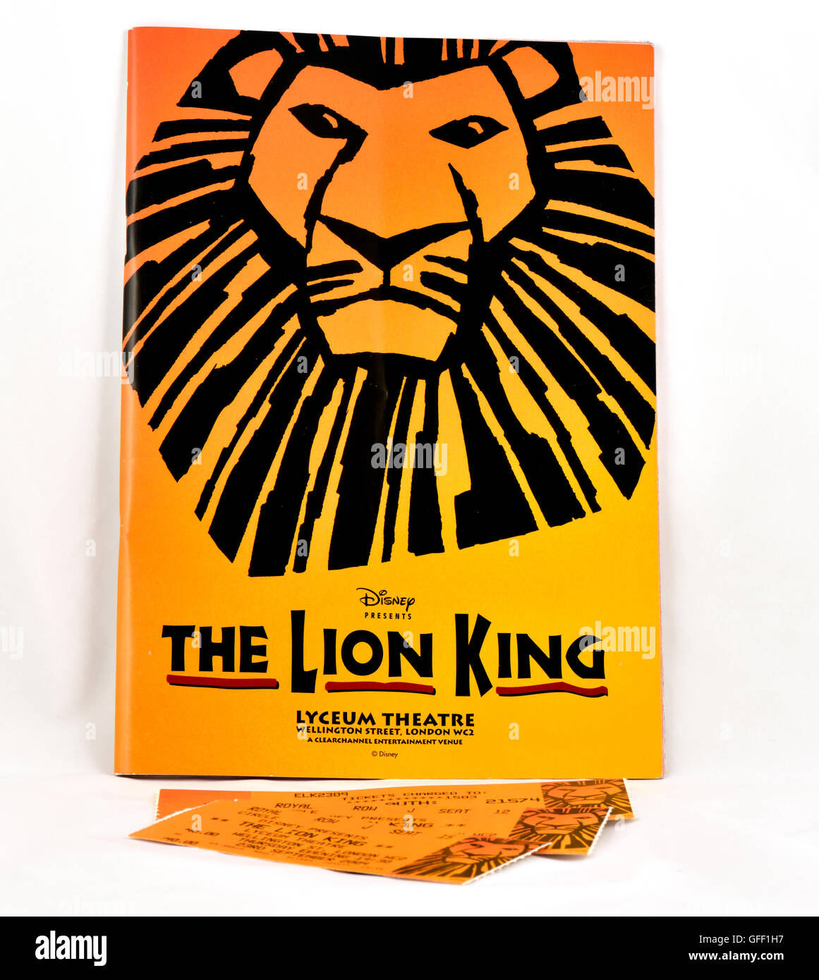 Programme for the Lyceum Theatre 'The Lion King' and tickets - Stock Image