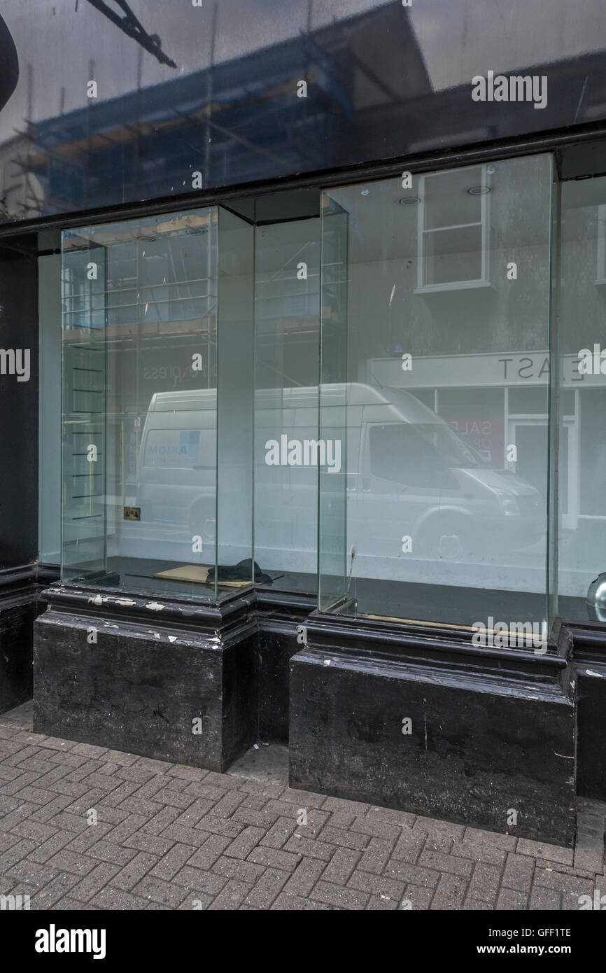 Empty shop window for recession concept / poor high street sales / unemployment, high street decline, death of the Stock Photo