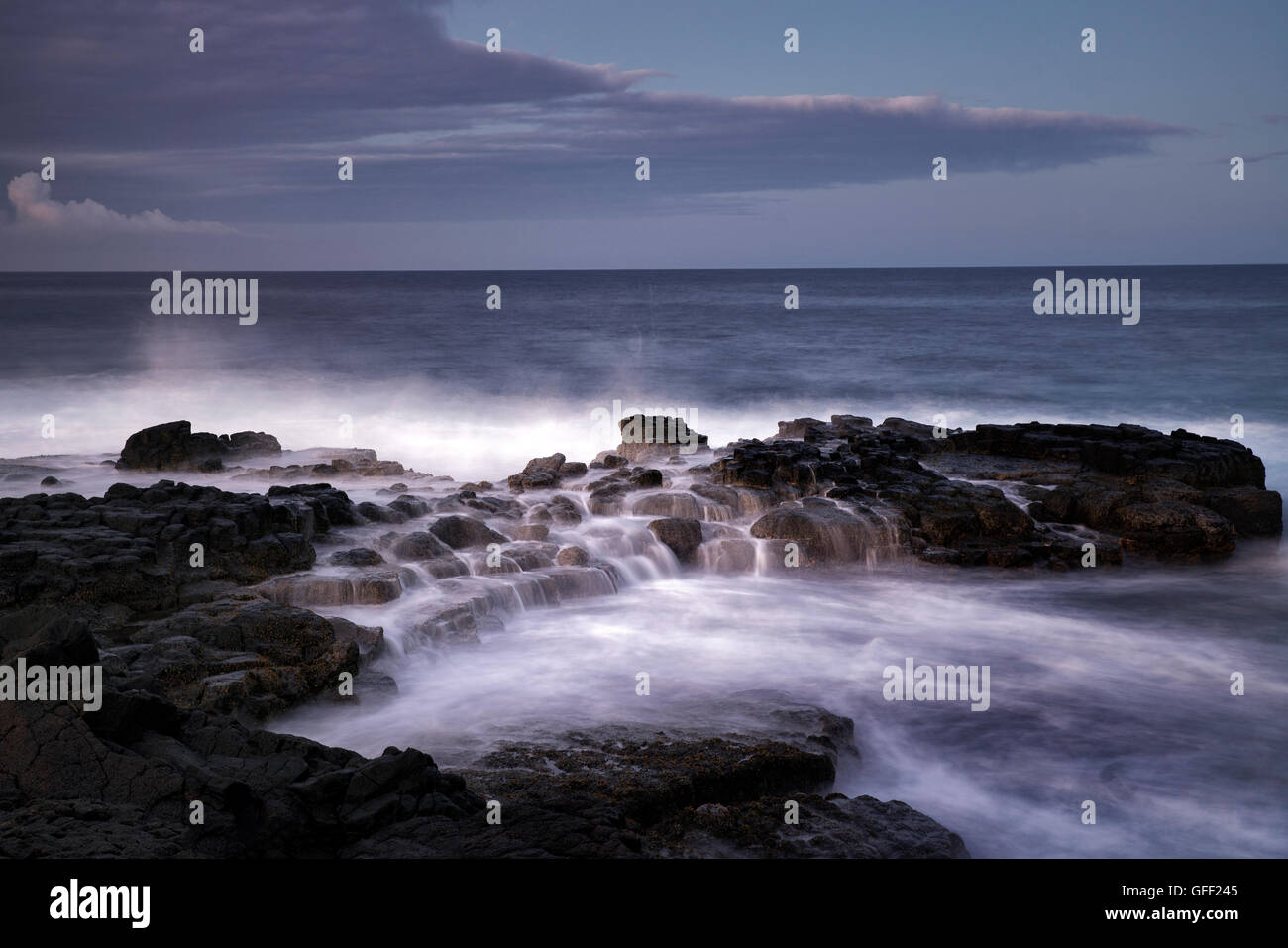 Ocean waves and sunrise. South Point. Hawaii, (The Big Island) Stock Photo